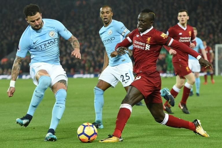 Kyle Walker (left) has the unenviable task of stopping Liverpool's top scorer Sadio Mane (right)