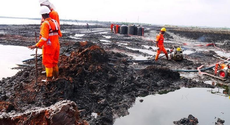 Shell workers on site in one of the oil regions used to illustrate the story