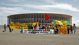 Demonstrators stand behind a banner reading 'We don't want the Copa, we want  vaccines' outside the Mane Garrincha stadium before the Copa America opening game Creator: Sergio Lima