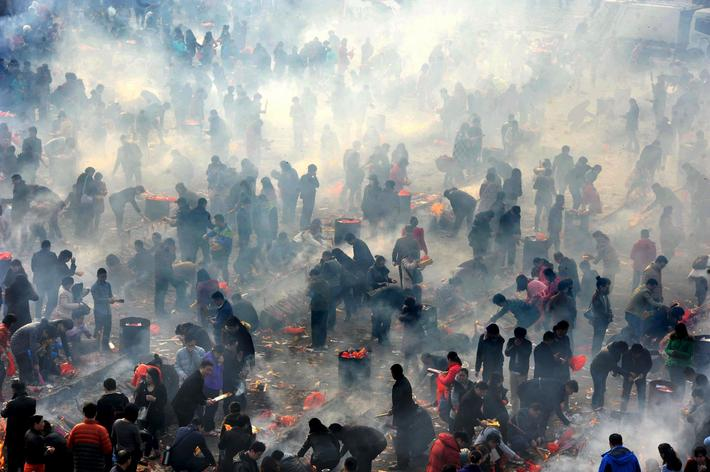 People burn incense to worship the God of Fortune at Guiyuan Temple on the fifth day of Chinese Luna
