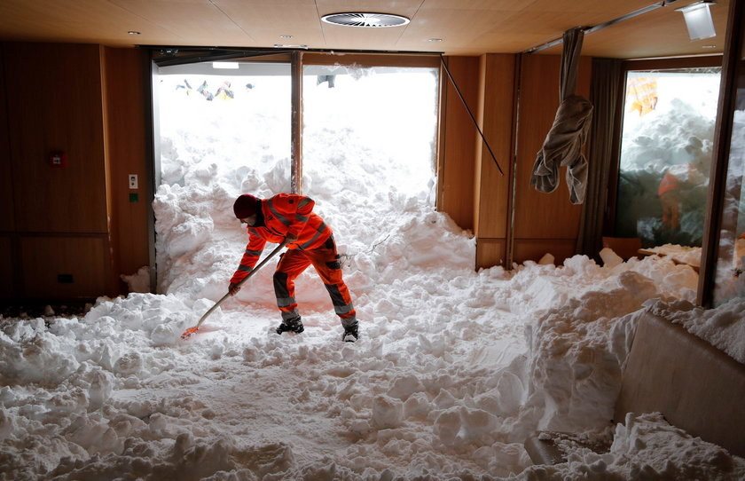 Workers shovel snow out of a restaurant after an avalanche at Santis-Schwaegalp mountain resort