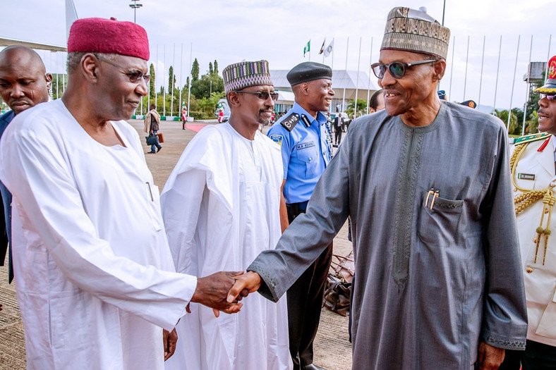 President Muhammadu Buhari (right) shakes hands with his Chief of Staff, Abba Kyari (left) [Presidency]