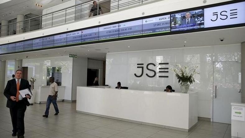 People walk near the reception at the Johannesburg Stock Exchange (JSE) in Sandton, Johannesburg, South Africa December 10, 2015.