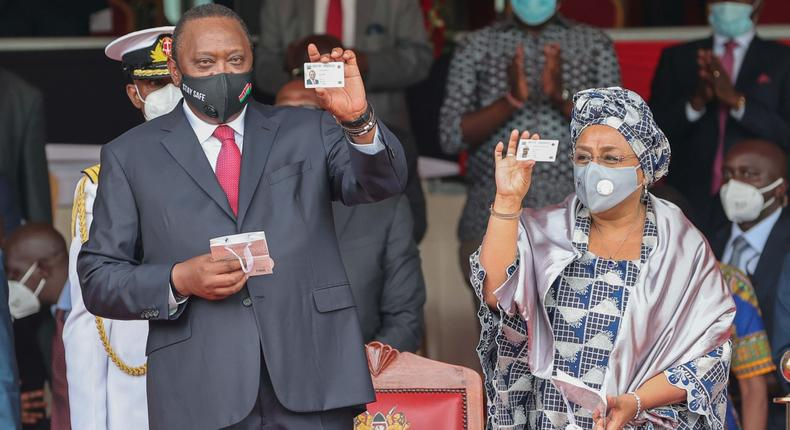 President Uhuru Kenyatta with First Lady Margaret Kenyatta after they received their Huduma Namba cads