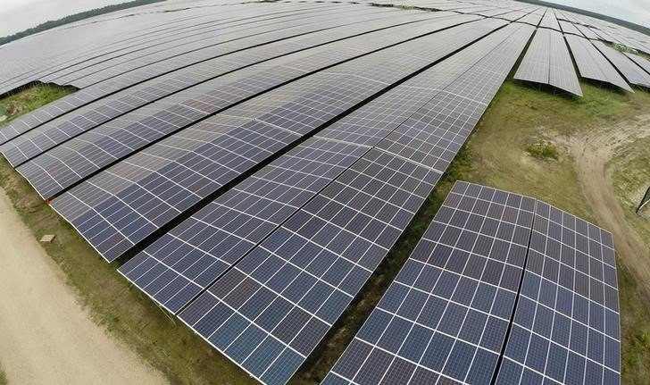 A general view shows solar panels used to produce renewable energy at the photovoltaic park in Cestas, southwestern France, June 19, 2015. REUTERS/Regis Duvignau