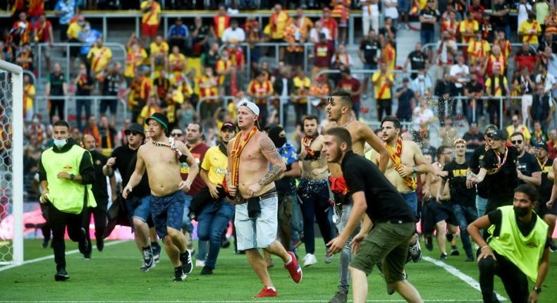 Lens fans run onto the pitch during half-time of the Ligue 1 game against Lille Creator: FRANCOIS LO PRESTI