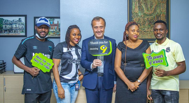 L-R: Studio Technician, Customer Care, 9mobile, Joshua Audu; Specialist, Quality Assurance, 9mobile, Winifred Inyang; Acting Chief Executive Officer, 9mobile, Jurgen Peschel; Executive Assistant to the CEO, Victoria Okon-Otoyo; and Specialist, Quality Assurance, Samuel Ajibodu at 9mobile's celebration of staff members during the 2021 Customer Service Week