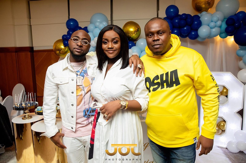 Davido, Chioma and Bankulli at the naming ceremony of Davido's son, Ifeanyi David Adeleke. (Bankulli)