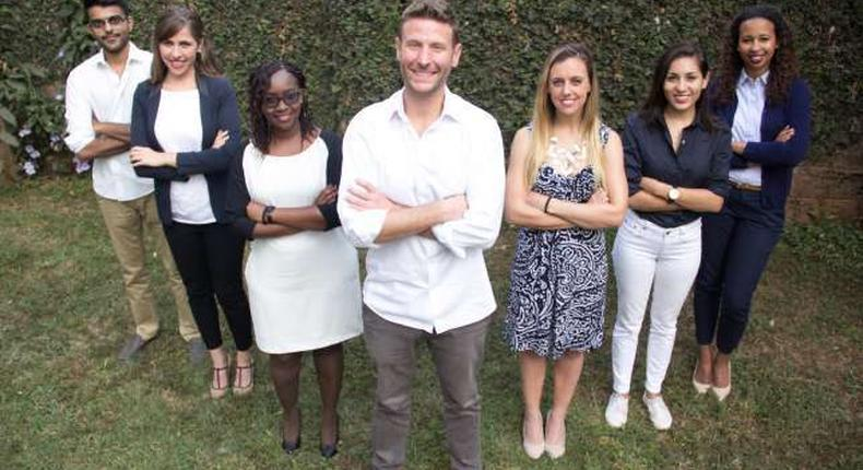 Jason Spindler (in the middle) surrounded by some of I-DEV International Kenyan staff.