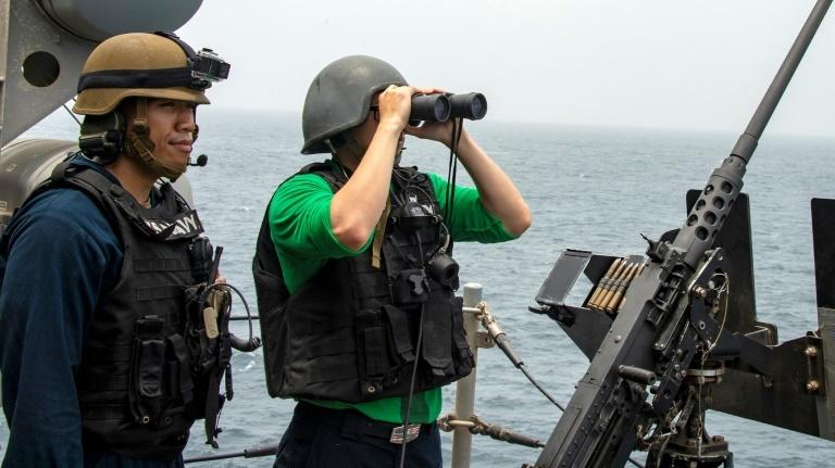US sailors aboard an amphibious assault ship survey the Strait of Hormuz on August 12, 2019