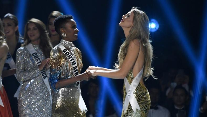Miss South Africa Zozibini Tunzi (L) and Miss Puerto Rico Madison Anderson (R), the two finalists, wait to hear the winner's name on stage during the 2019 Miss Universe pageant at the Tyler Perry Studios in Atlanta, Georgia