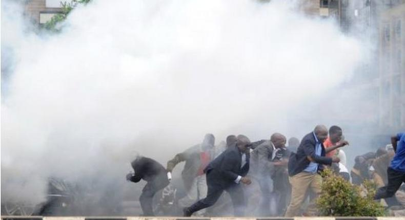 File image of police using teargas canisters to disperse rowdy crowds at a past political event. Police moved in swiftly to disperse rowdy youths who attempted to disrupt a Team Embrace ally in Garissa on Saturday