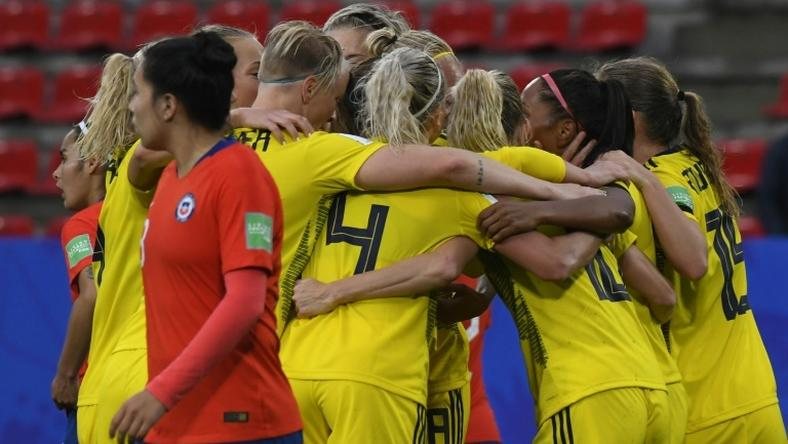 Sweden scored two late goals to beat Chile after a lengthy delay in their game due to a storm