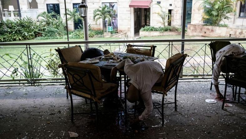 Bodies of victims are seen at a restaurant's terrace after a bomb attack at a Nairobi hotel complex on January 15
