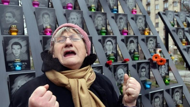 A woman cries at a memorial in Kiev for activists who lost their lives in February 2014, on November 21, 2016