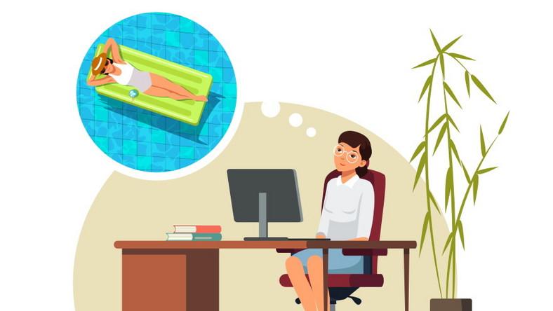 Kobieta w pracy myśli o urlopie