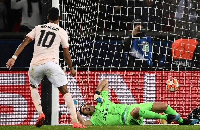 Manchester United forward Marcus Rashford scores from the penalty spot against Paris Saint-Germain