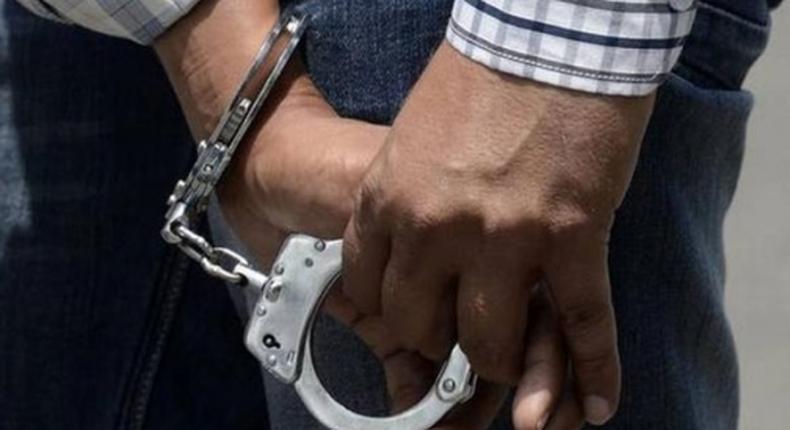 A criminal in handcuffs