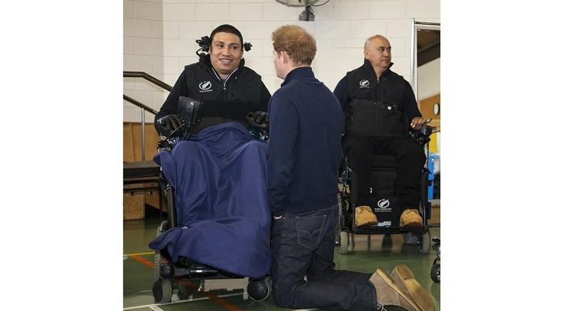 Prince Harry kneels in New Zealand