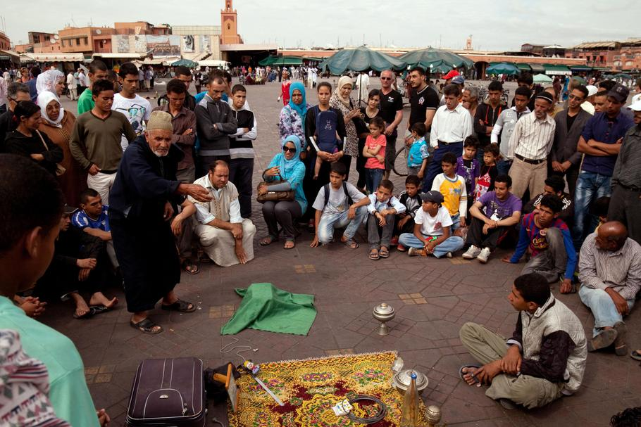 Arab Storyteller and crowd, Djemma el Fna Square Marrakech Morocco Africa