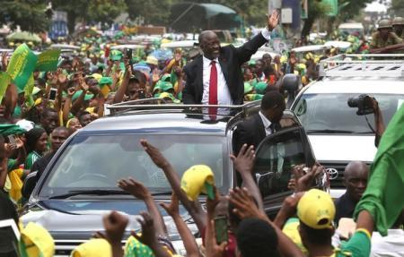 "Tanzania""s President elect John Pombe Magufuli (C) salutes members of the ruling Chama Cha Mapinduzi Party (CCM) as he arrives at the party""s sub-head office on Lumumba road in Dar es Salaam, October 30, 2015."