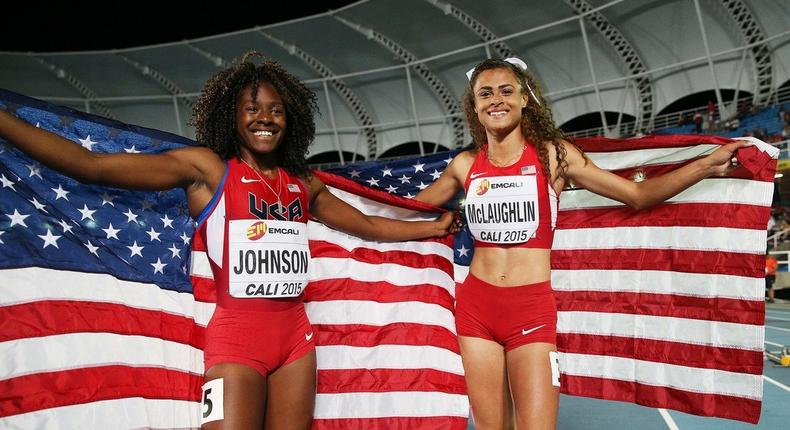 Sydney McLaughlin and Brandee Johnson of the USA celebrate with flags after the Girls 400 Meters Hurdles Final at a past Youth Championships.