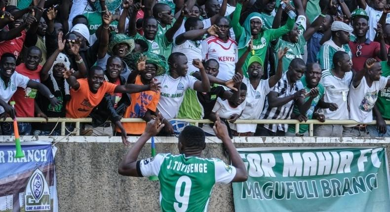 Former Gor Mahia player, Jacques Tuyisenge celebrates with supporters after scoring his first goal during their CAF Confereration cup football match against Egypt's Zamalek at The Kasarani Stadium in Nairobi on February 3, 2019. - Kenya's Gor Mahia won by 4-2 against Egypt's Zamalek. (Photo by Yasuyoshi CHIBA / AFP) (Photo credit should read YASUYOSHI CHIBA/AFP via Getty Images)