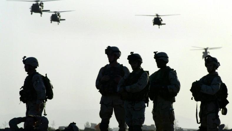 American soldiers wait to board helicopters at Kandahar airbase in Afghanistan in 2003