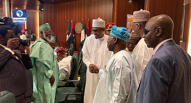President Muhammadu Buhari shakes hands with former president, Olusegun Obasanjo [Channels TV]