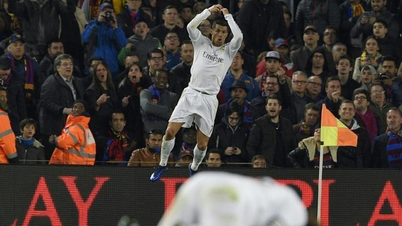 Real Madrid's forward Cristiano Ronaldo celebrates after scoring a goal against in Barcelona on April 2, 2016