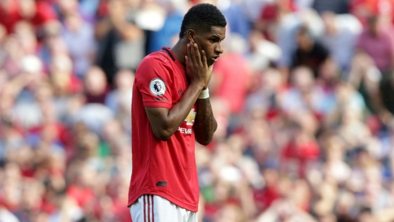 Manchester United striker Marcus Rashford reacts after mssing his penalty