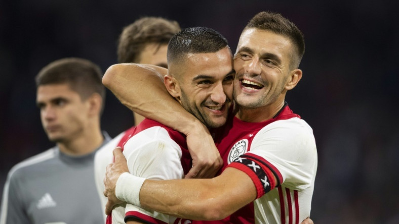 Dusan Tadic (R) fired Ajax into the Champions League playoff with two penalties