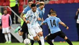 Nicolas Gonzalez (L) in action at the Copa America with Argentina. Creator: EVARISTO SA