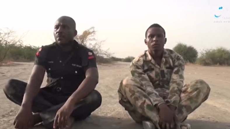 Police inspector, Yohanah Kilus (left), and Lance Corporal Emmanuel Oscar (right) were executed by masked terrorists on camera Sahara TV]