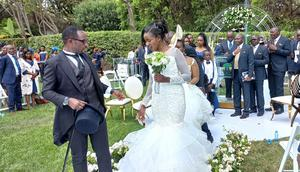 Silas Jakakimba and his bride Florence during their wedding held at the Safari Park Hotel in Nairobi on October 16, 2021