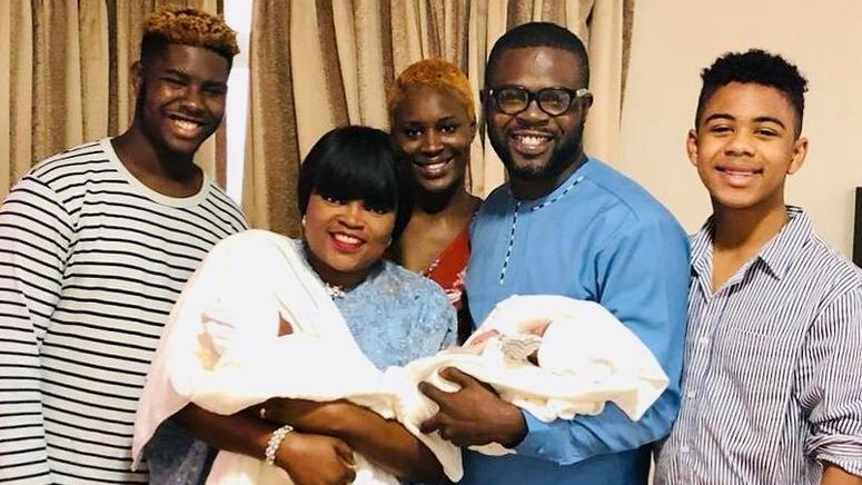 Funke Akindele joins her family, who now include newborn twins, in an intimate picture. - Instagram/funkejenifaakindele