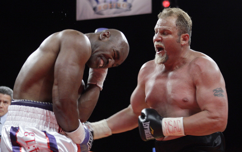 Francois Botha of South Africa (R) punches on Evander Holyfield of the U.S. during a heavyweight bout at the Thomas & Mack Center in Las Vegas, Nevada April 10, 2010.