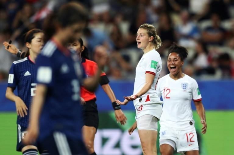 England forward Ellen White celebrates with number 12 Demi Stokes after scoring her second goal in the 2-0 win over Japan