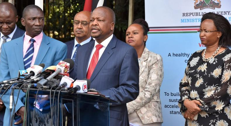 Health CS Mutahi Kagwe flanked by other government officials at a recent Covid-19 press conference