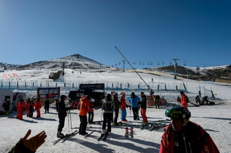 Tourists prepare to ski at El Colorado skiing center