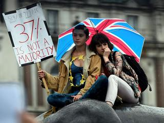 Demonstrators take part in a protest aimed at showing London's solidarity with the European Union fo