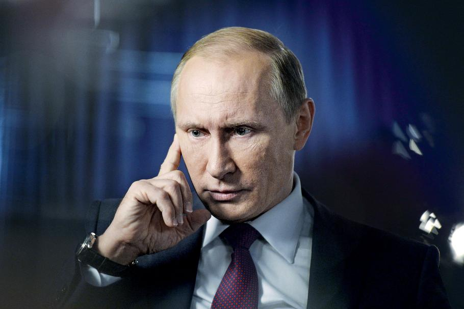 Russian President Putin answers questions by Russia 1 channel's anchor Solovyov during interview in