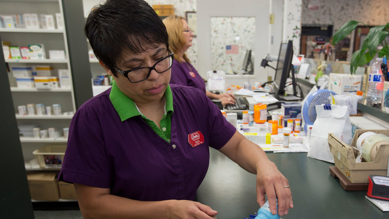 In this Friday, July 8, 2016, photo, pharmacist technician Irene Arrenquin fills a prescription for the anti-diarrhea drug diphenoxylate hydrochloride and atropine sulfate at Pucci's Pharmacy, in Sacramento, Calif. The drug is one of several that has seen a significant cost increase in recent months.