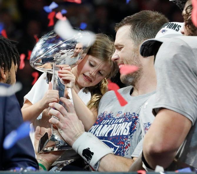Tom Brejdi sa ćerkicom