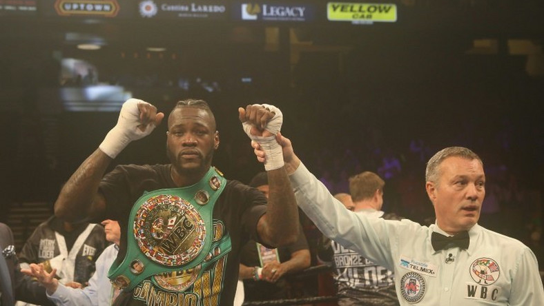 Deontay Wilder started poorly in front of hometown fans, but sprang to life in the fifth round, knocking Gerald Washington down to retain his WBC heavyweight title