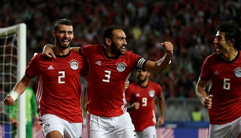 Egypt defenders Baher El-Mohamady (L) celebrates with his Ahmed Elmohamady (C) and Ahmed Hegazi (R) after scoring a goal during the Africa Cup of Nations qualifier football match against Tunisia near Alexandria November 16, 2018
