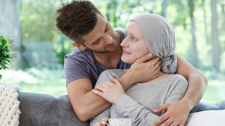 <p>Sick girlfriend in headscarf after radiotherapy supported by loving boyfriend</p>