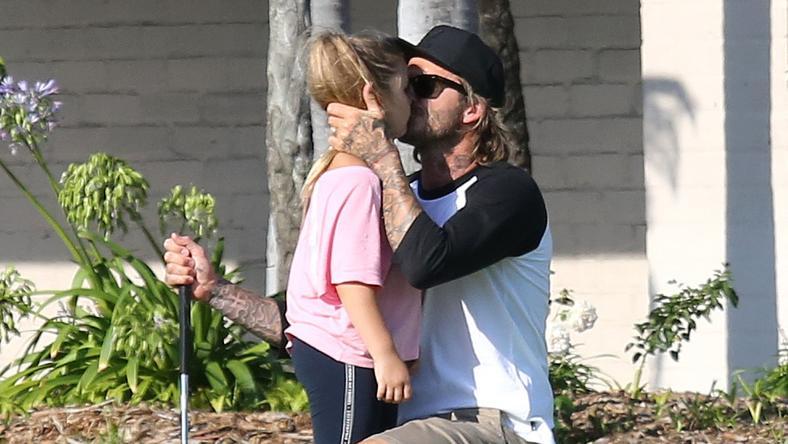 David Beckham z dziećmi na polu golfowym