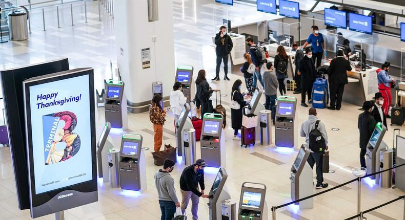 Travelers at New York's LaGuardia Airport.