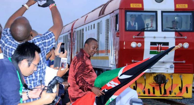 President Uhuru Kenyatta flagging off one of the SGR trains on May 30, 2017